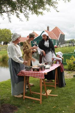 In Zaanse Schans people wear traditional Dutch clothing and visitors to Holland can get a glimpse into the past of the Netherlands.