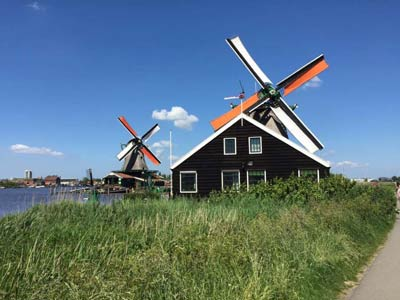 There are 10 windmills running in the region around Zaanse Schans a traditional Dutch village in the Netherlands.
